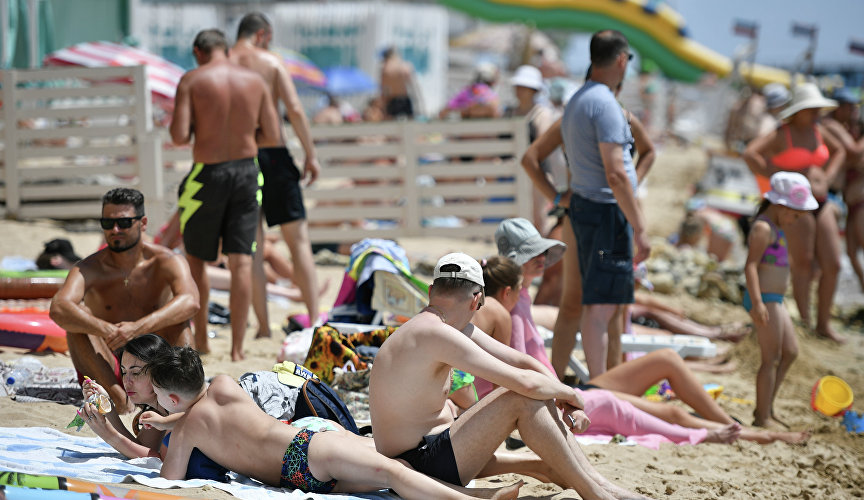 Vacationers on the beach in Evpatoria